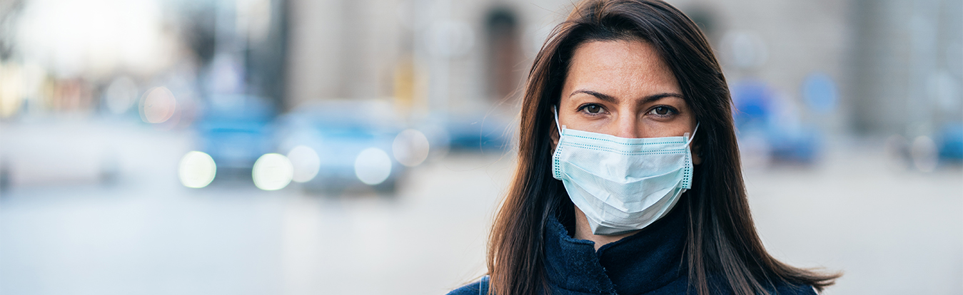 A female attorney wearing a face mask