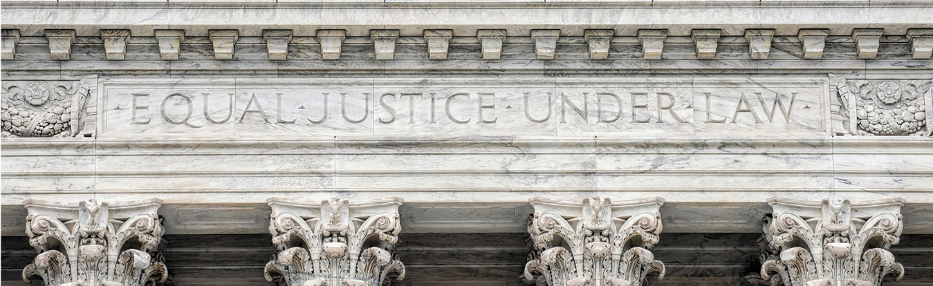 "A courthouse facade that reads ""Equal justice for all..."""