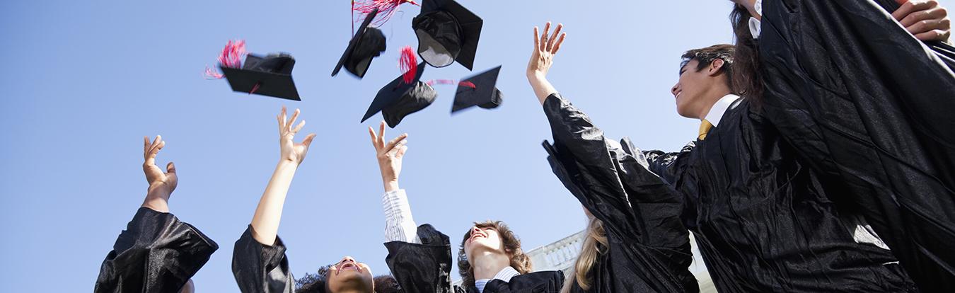 Graduates tossing morter boards