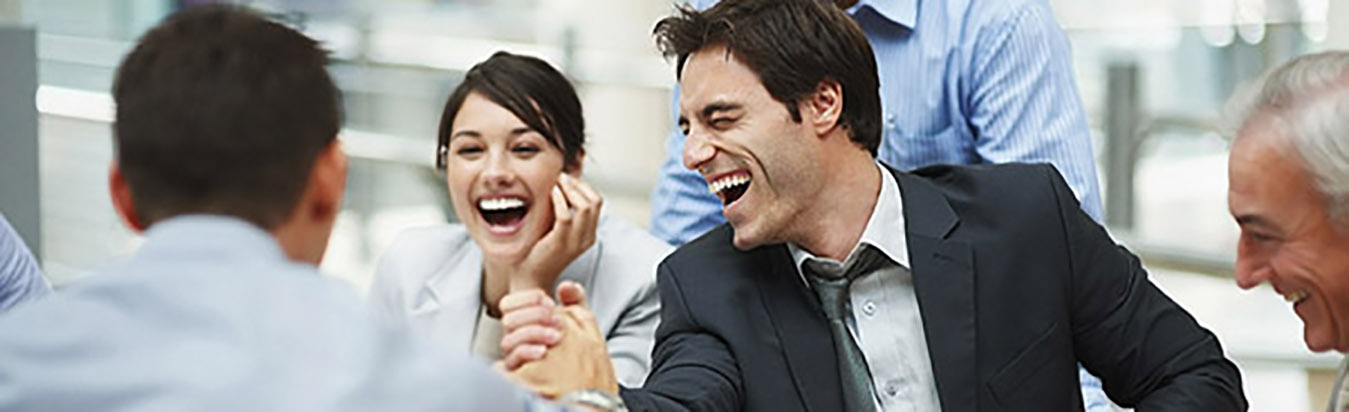 Lawyers laughing at a gathering