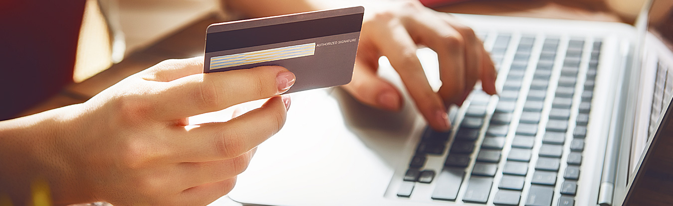 Image of someone using their credit card to make purchases online.