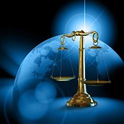 Globe behind a law scale