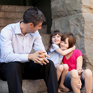 A male adult advocate and two children